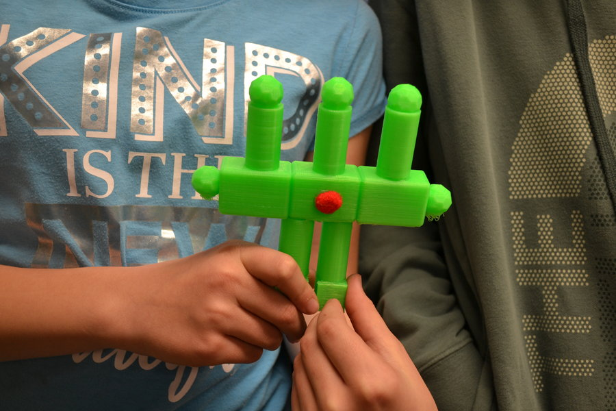 Close up of a student holding their 3D super gadget