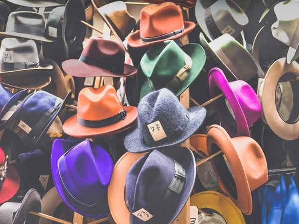 multicoloured fedora hats on a rack